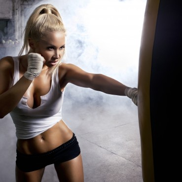 bigstock-Young-Woman-Fitness-Boxing-In-49886171